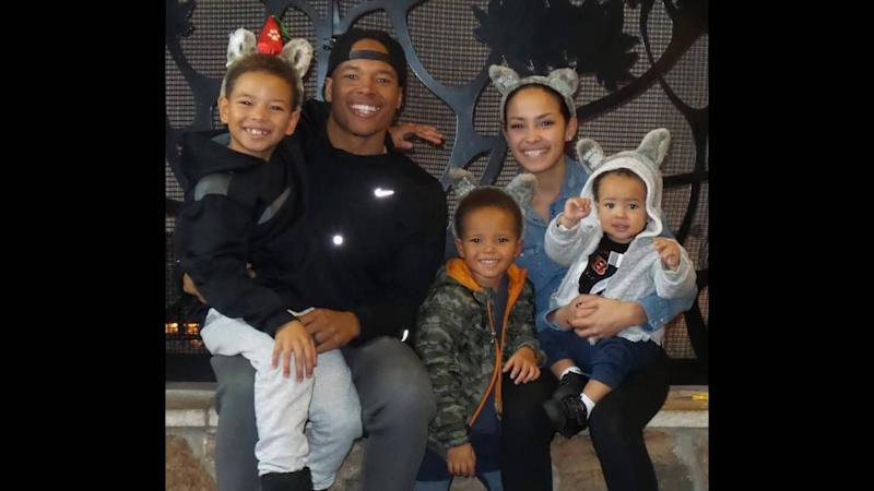 A cute family photo of the Jones smiling adorable in casual clothes