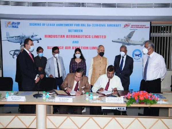 Officials of HAL and Air Alliance signing the deal (Photo/ANI)