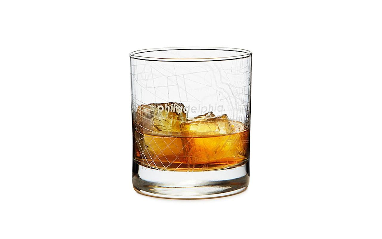 """<p>Celebrate familiar travel destinations with these etched rock glasses. Each features a different city grid.</p> <p>To buy: <a href=""""https://uncommongoods.sjv.io/c/249354/483884/8444?subId1=TL%2CGiftsforMenWhoLovetoTravel%2Cwarrenj%2CGIF%2CGAL%2C455939%2C201911%2CI&u=https%3A%2F%2Fwww.uncommongoods.com%2Fproduct%2Fcity-map-glass"""" target=""""_blank"""">uncommongoods.com</a>, $16</p>"""