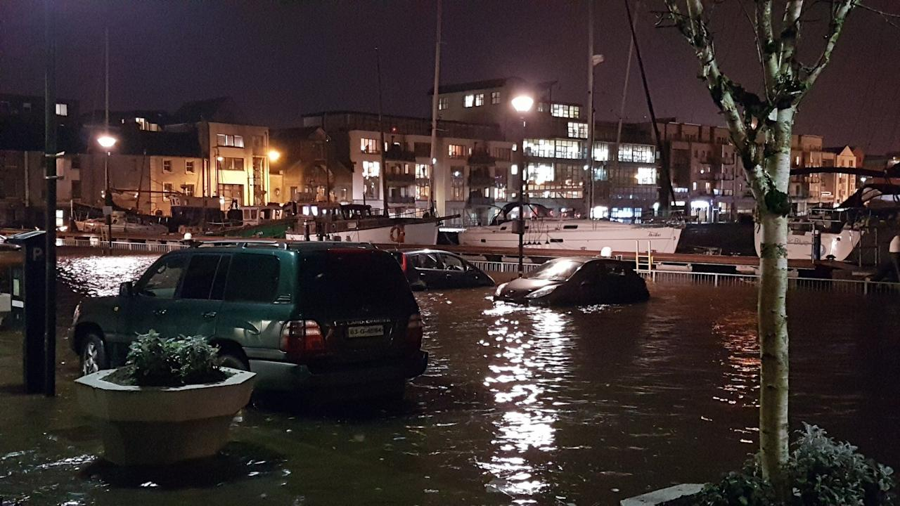 <p>Flooded cars are seen floating in the streets of Galway (Emma Hayward) </p>