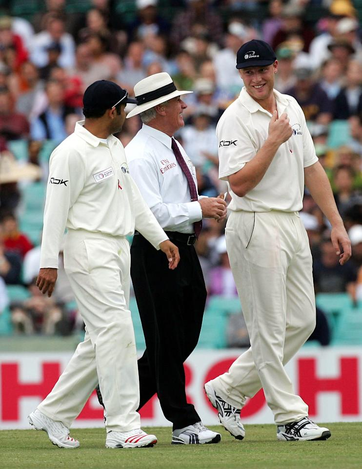 SYDNEY, NSW - OCTOBER 16:  Umpire Rudi Koertzen (centre) chats with Virender Sehwag (left) and Andrew Flintoff of the ICC World XI as they leave the field because of bad light during day three of the Johnnie Walker Super Series Test between Australia and the ICC World XI played at the Sydney Cricket Ground on October 16, 2005 in Sydney, Australia.  (Photo by Hamish Blair/Getty Images)