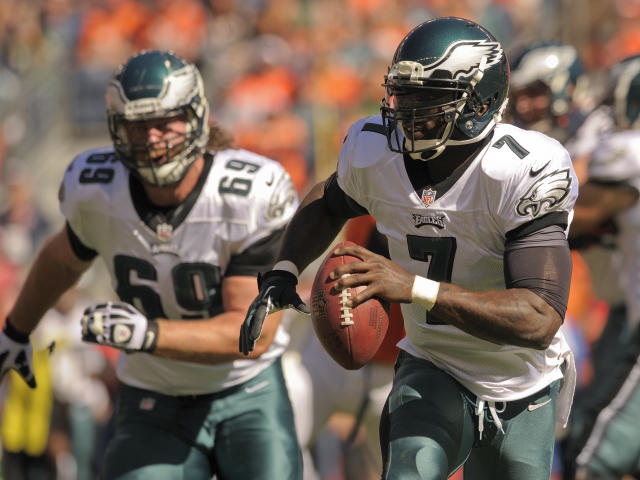 Philadelphia Eagles quarterback Michael Vick (7) runs the ball against the Denver Broncos in the first quarter of an NFL football game, Sunday, Sept. 29, 2013, in Denver. (AP Photo/Jack Dempsey)