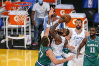 Los Angeles Lakers' LeBron James (23) goes to the basket while defended by Dallas Mavericks' Luka Doncic (77) during the first half of an NBA basketball game Friday, Dec. 25, 2020, in Los Angeles. (AP Photo/Ringo H.W. Chiu)