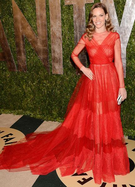 <b>Best dressed: Hilary Swank </b><br><br>The Million Dollar Baby actress looked stunning in this red Valentino SS13 Couture gown at the Vanity Fair Party.<br><br>Image © Rex