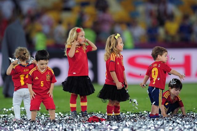 KIEV, UKRAINE - JULY 01: The Spanish Players Children play on the pitch after the UEFA EURO 2012 final match between Spain and Italy at the Olympic Stadium on July 1, 2012 in Kiev, Ukraine. (Photo by Shaun Botterill/Getty Images)