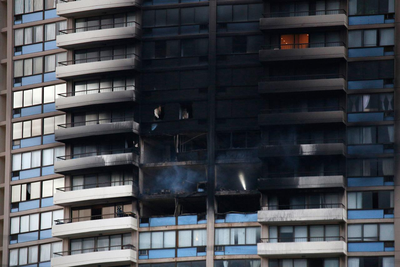 <p>The charred exterior of the Marco Polo Building is pictured after a fire broke out on the upper floors in Honolulu, Hawaii, on July 14, 2017. (Photo: Kent Nishimura/AFP/Getty Images) </p>