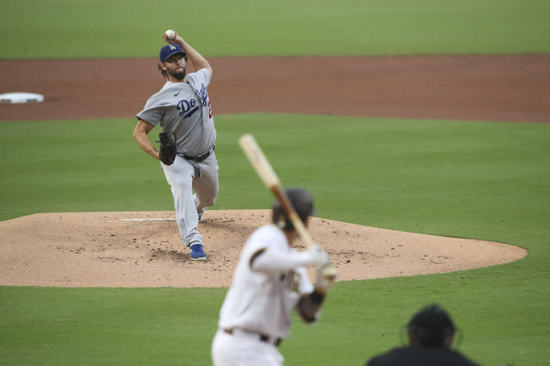 Los Angeles Dodgers starting pitcher Clayton Kershaw, top, delivers to San Diego Padres' Manny Machado in first inning of a baseball game Monday, Sept. 14, 2020, in San Diego. (AP Photo/Derrick Tuskan)