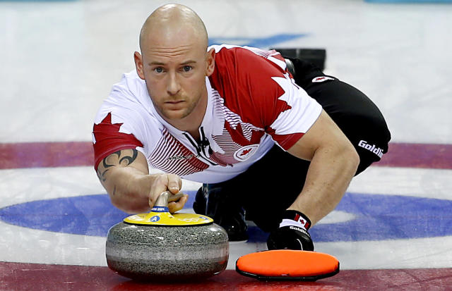 Canada's Ryan Fry delivers the rock during the men's curling match against the United States at the 2014 Winter Olympics, Sunday, Feb. 16, 2014, in Sochi, Russia. (AP Photo/Wong Maye-E)
