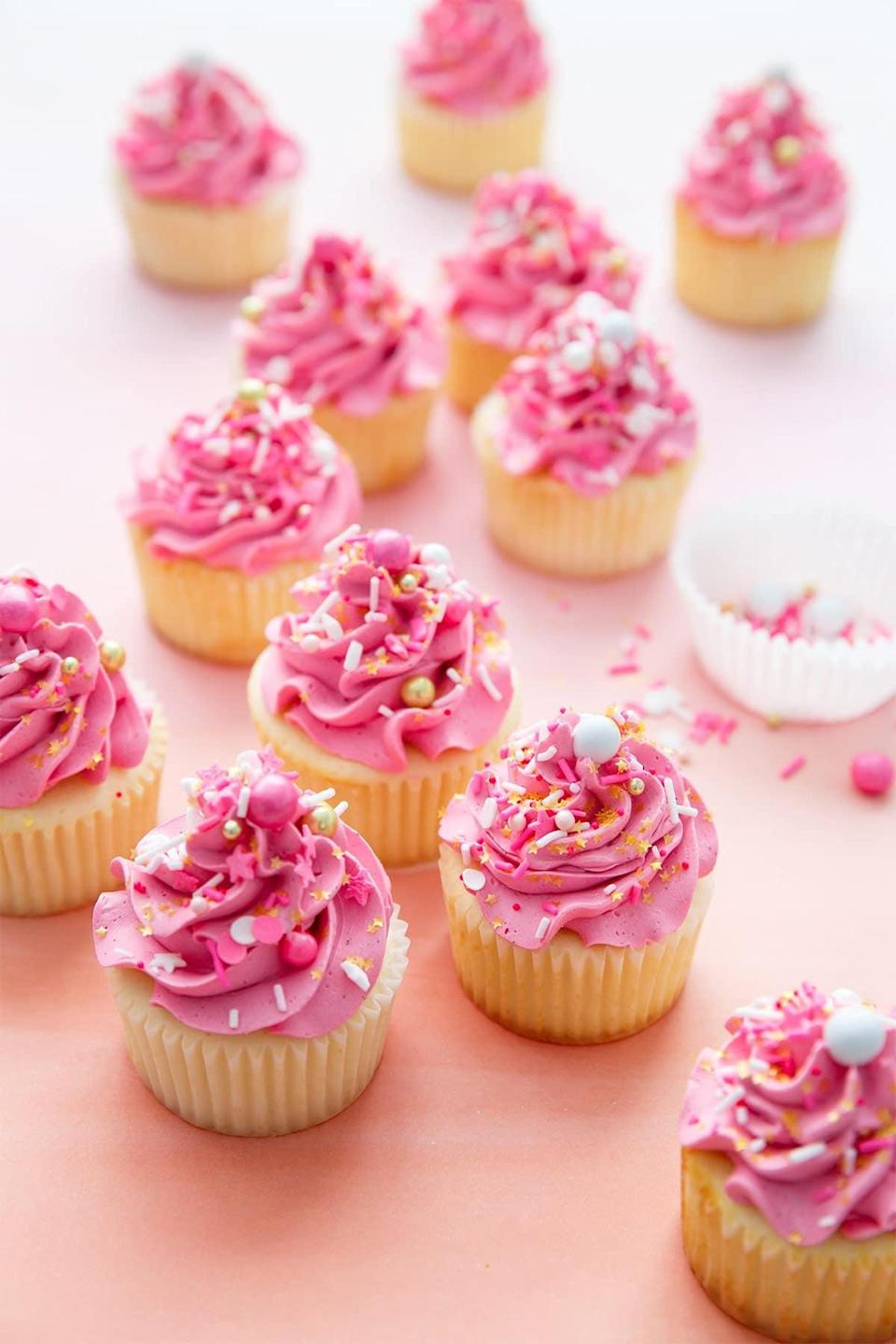 "<p>Warning: these moist white cupcakes are topped with a mound of buttercream and filled with sprinkles - and wow, are they good. They're sweet, cute, and perfect for a Galentine's Day celebration, so we suggest making more than one batch of these, because they're just that good.</p> <p><strong>Get the recipe</strong>: <a href=""https://www.loveandoliveoil.com/2017/10/sprinkle-filled-cupcakes-marshmallow-buttercream.html"" class=""link rapid-noclick-resp"" rel=""nofollow noopener"" target=""_blank"" data-ylk=""slk:sprinkle-filled cupcakes with marshmallow buttercream"">sprinkle-filled cupcakes with marshmallow buttercream</a></p>"