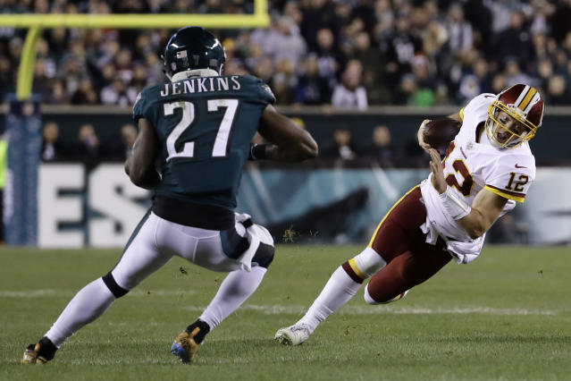 Washington Redskins' Colt McCoy (12) tries to avoid Philadelphia Eagles' Malcolm Jenkins (27) but ended up injuring his leg. (AP)