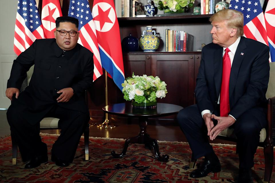 U.S. President Donald Trump and North Korea's leader Kim Jong Un meet in a one-on-one bilateral session at the start of their summit at the Capella Hotel on the resort island of Sentosa, Singapore June 12, 2018. Picture taken June 12, 2018. REUTERS/Jonathan Ernst