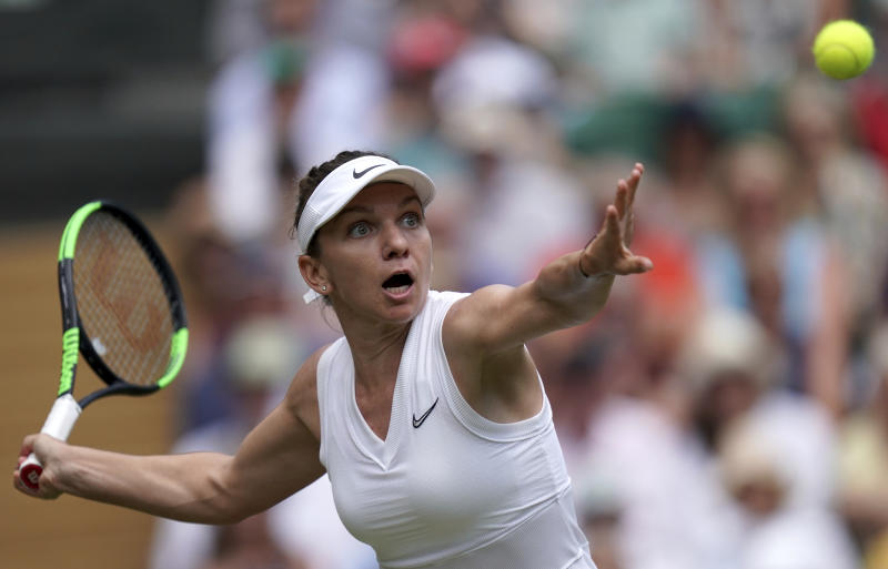 Romania's Simona Halep returns to Ukraine's Elina Svitolina in a Women's semifinal singles match on day ten of the Wimbledon Tennis Championships in London, Thursday, July 11, 2019. (Will Oliver/Pool Photo via AP)
