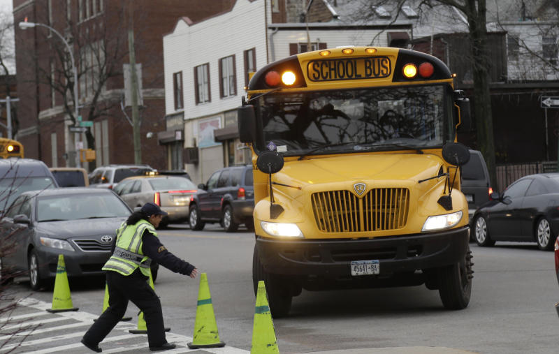 A school bus arrives to drop off students in New York, Tuesday, Jan. 15, 2013. A strike by New York City school bus drivers that had been threatened for weeks will start Wednesday morning, affecting 152,000 students, the president of the union representing the drivers announced Monday. (AP Photo/Seth Wenig)