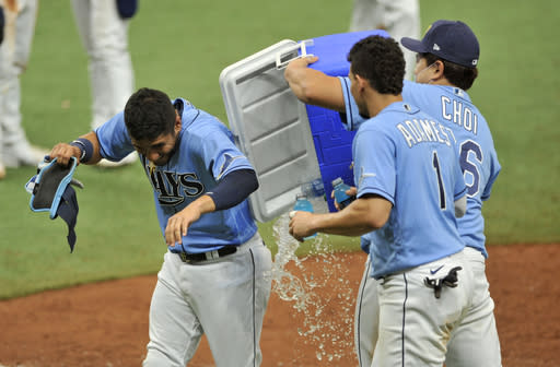 From left to right, Tampa Bay Rays' Michael Perez, Willy Adames and Ji-Man Choi celebrate a win over the New York Yankees in a baseball game Sunday, Aug. 9, 2020, in St. Petersburg, Fla. (AP Photo/Steve Nesius)