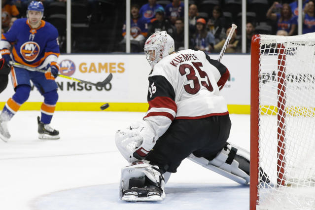 Arizona Coyotes goaltender Darcy Kuemper (35) watches the puck shot by New York Islanders' Josh Bailey for a goal during the second period of an NHL hockey game Thursday, Oct. 24, 2019, in Uniondale, N.Y. (AP Photo/Frank Franklin II)