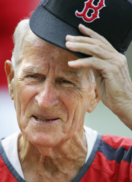 FILE - In this Aug. 31, 2006, file photo, Boston Red Sox great Johnny Pesky lifts his cap during a television interview before a baseball game against the Toronto Blue Jays in Boston. Pesky, who spent most of his 60-plus years in pro baseball with the Red Sox and was beloved by the team's fans, has died on Monday, Aug. 13, 2012, in Danvers, Mass. He was 92. (AP Photo/Michael Dwyer, File)