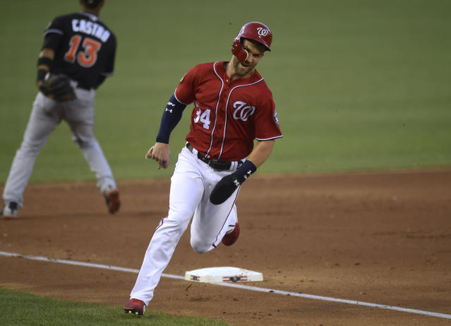 Washington Nationals' Bryce Harper (34) rounds third base and head to home plate to score on a double by teammate Mark Reynolds during the fourth inning of a baseball game against the Miami Marlins at Nationals Park in Washington, Saturday, July 7, 2018. (AP Photo/Susan Walsh)