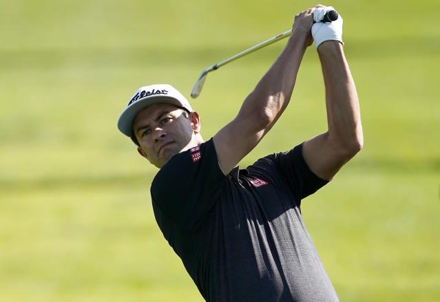 Adam Scott, of Australia, hits his second shot on the second hole during the third round of the Genesis Invitational golf tournament at Riviera Country Club, Saturday, Feb. 15, 2020, in the Pacific Palisades area of Los Angeles. (AP Photo/Ryan Kang)