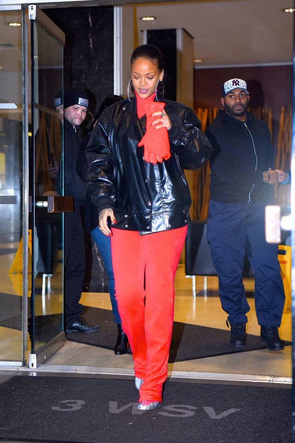 <p>In a red Vetements x Juicy Couture tracksuit, Vetements metallic boots, black leather jacket, red leather gloves and diamond hoop earrings while out in New York.</p>