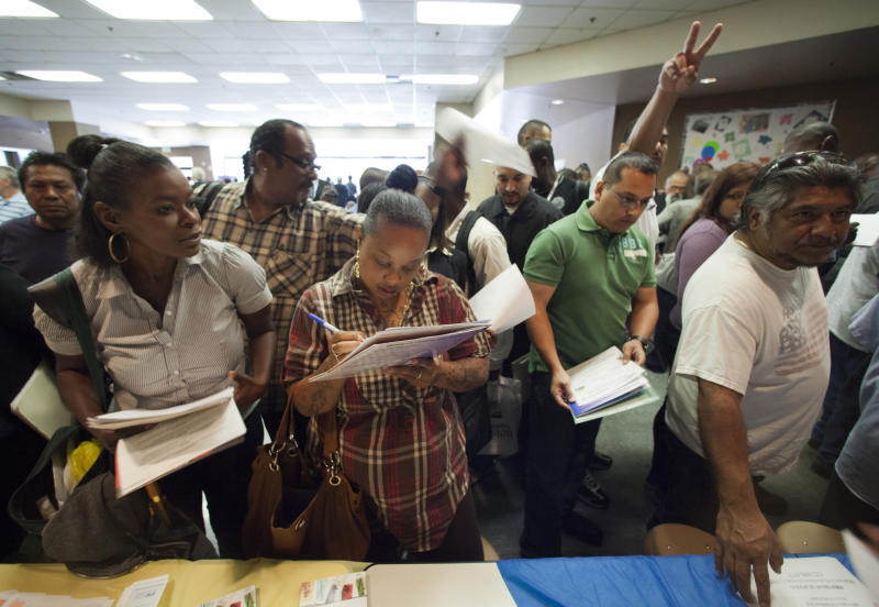 In this Thursday, May 31, 2012, job seekers gather for employment opportunities at the 11th annual Skid Row Career Fair at the Los Angeles Mission in Los Angeles. U.S. employers created 69,000 jobs in May, the fewest in a year, and the unemployment rate ticked up. The dismal jobs figures could fan fears that the economy is sputtering. (AP Photo/Damian Dovarganes, File)