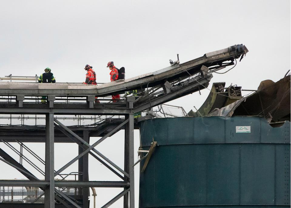 <p>Emergency services at the scene of a fatal explosion at water treatment works in Avonmouth, near Bristol</p> (EPA)