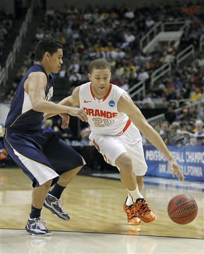 Syracuse guard Brandon Triche (20) drives against California guard Brandon Smith (12) during the first half of a third-round game in the NCAA college basketball tournament Saturday, March 23, 2013, in San Jose, Calif. (AP Photo/Tony Avelar)