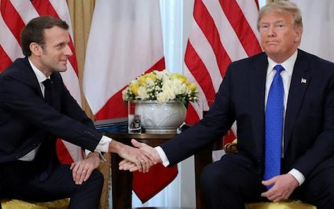 <span>Trump and Macron shake hands</span> <span>Credit: AFP </span>