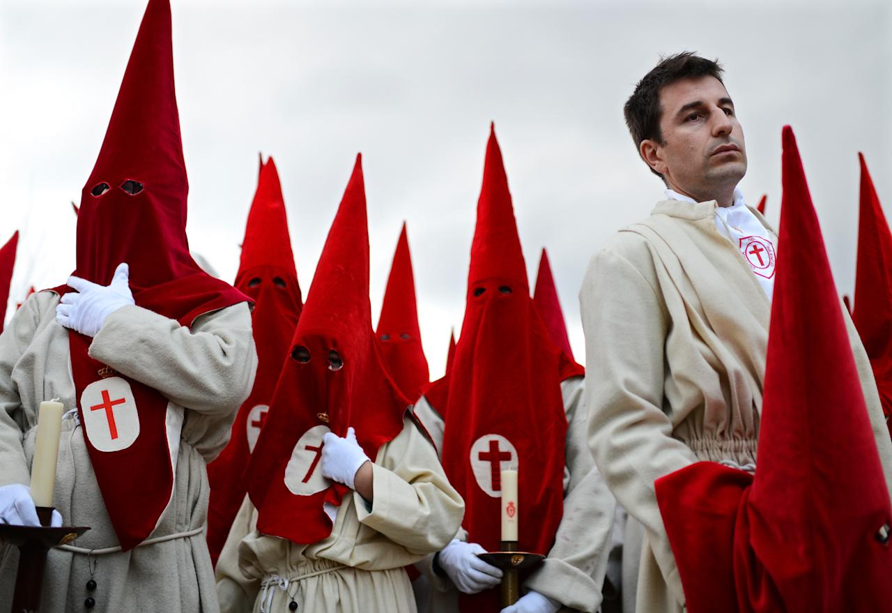 ZAMORA, SPAIN - APRIL 04:  Penitents of the Cofradia del Silencio wait for the start of their cofradia's Holy Week procession shortly before it was cancelled due to the rain on April 4, 2012 in Zamora, Spain. Easter week is traditionally celebrated with processions in most Spanish towns.  (Photo by Jasper Juinen/Getty Images)