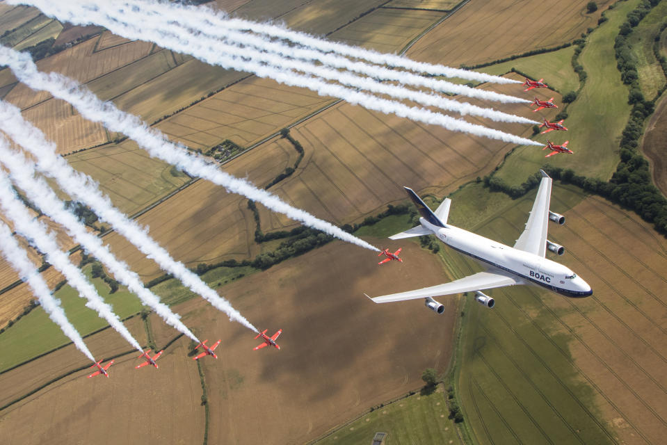 Image of the Royal Air Force Aerobatic team, the Red Arrows and a British Airways Boeing 747, seen here carrying out a flypast over the Royal International Air Tattoo at RAF Fairford (Picture: UK MOD/Crown 2019)