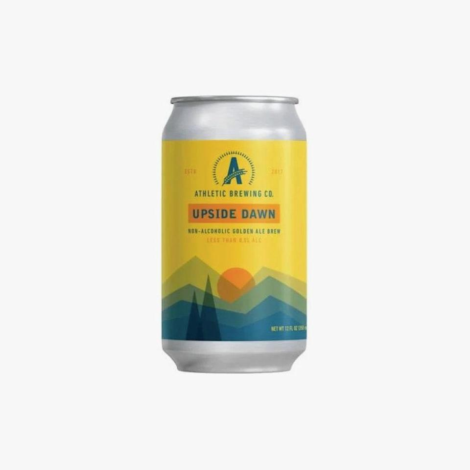 """$15, minibar.com. <a href=""""https://minibardelivery.com/store/product/athletic-brewing-upside-dawn-non-alcoholic-6-pack/athletic-brewing-upside-dawn-non-alcoholic-6-pack-12oz-cans"""" rel=""""nofollow noopener"""" target=""""_blank"""" data-ylk=""""slk:Get it now!"""" class=""""link rapid-noclick-resp"""">Get it now!</a>"""