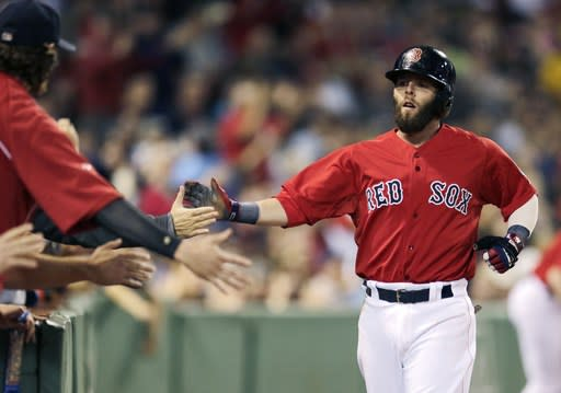 Boston Red Sox's Dustin Pedroia is congratulated by teammates after scoring on a wild pitch by Toronto Blue Jays' Esmil Rogers during the first inning of a baseball game at Fenway Park, Friday, Sept. 20, 2013, in Boston. (AP Photo/Charles Krupa)