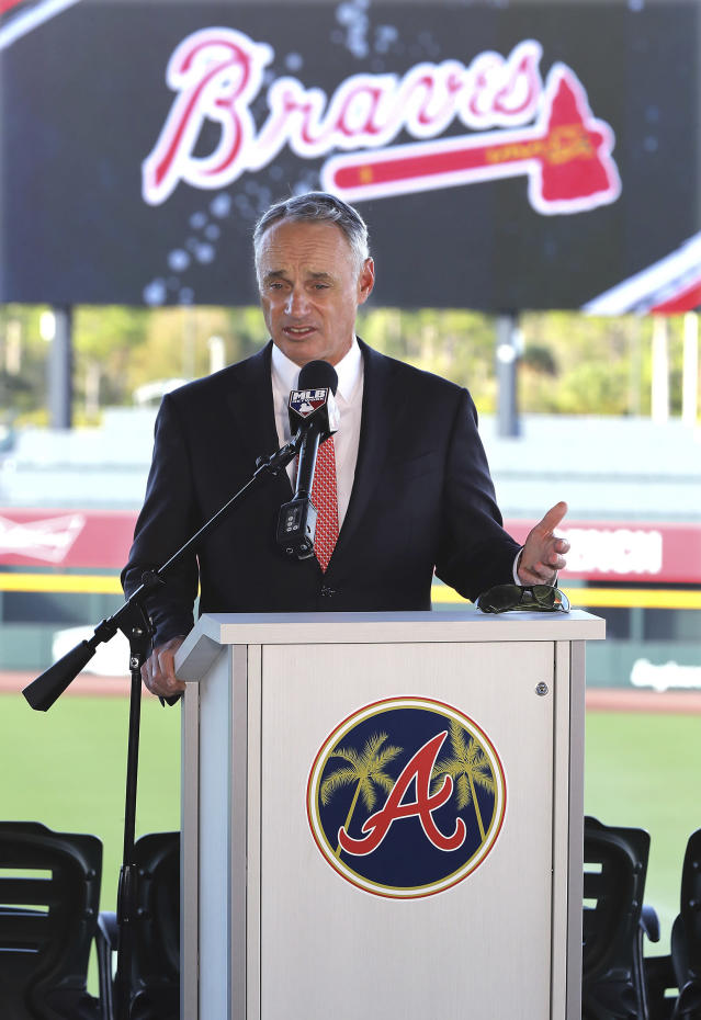 Baseball Commissioner Rob Manfred takes questions about the Houston Astros during a news conference at the Atlanta Braves' spring training facility Sunday, Feb. 16, 2020, in North Port, Fla. (Curtis Compton/Atlanta Journal-Constitution via AP)