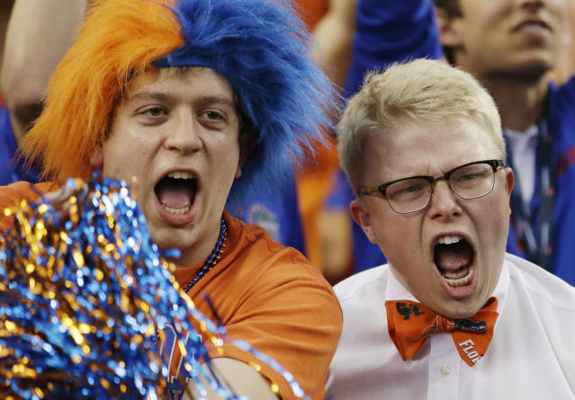 Florida fans cheer before an NCAA Final Four tournament college basketball semifinal game against Connecticut Saturday, April 5, 2014, in Arlington, Texas. (AP Photo/David J. Phillip)