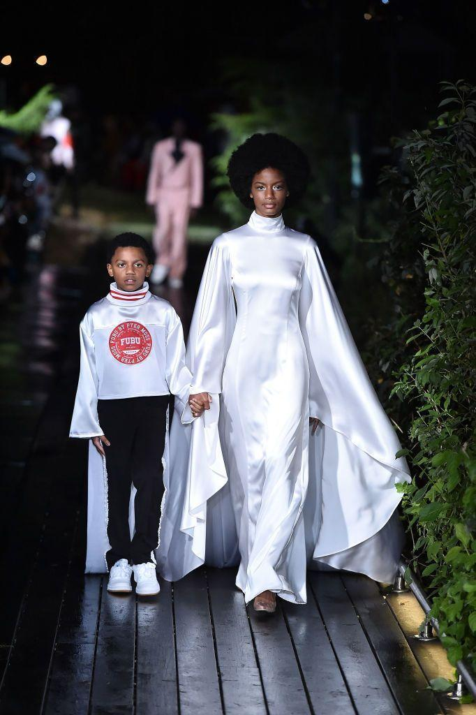 """<p>The American design house <a href=""""https://www.elle.com/uk/fashion/celebrity-style/articles/a41597/black-history-at-pyer-moss/"""" rel=""""nofollow noopener"""" target=""""_blank"""" data-ylk=""""slk:Pyer Moss"""" class=""""link rapid-noclick-resp"""">Pyer Moss</a> took to <a href=""""https://www.instagram.com/p/B94TaSygsRF/"""" rel=""""nofollow noopener"""" target=""""_blank"""" data-ylk=""""slk:Instagram"""" class=""""link rapid-noclick-resp"""">Instagram</a> to request donations of medical masks and latex gloves to their New York City office. </p><p>The brand, founded by Kerby Jean-Raymond, also set aside $5,000 (£4,253.12) to purchase these items.</p><p>'In the last few days; I've been getting an influx of messages from medical professionals on the front lines, who have been treating this pandemic, about their shortage of basic supplies.' The Instagram post detailed.</p><p>'Many of them, including my sister, have not had enough n95 masks and some are without gloves. My sister was exposed to Covid-19 and her elder patients' safety have been compromised due to some professionals having to wear makeshift masks.'</p>"""