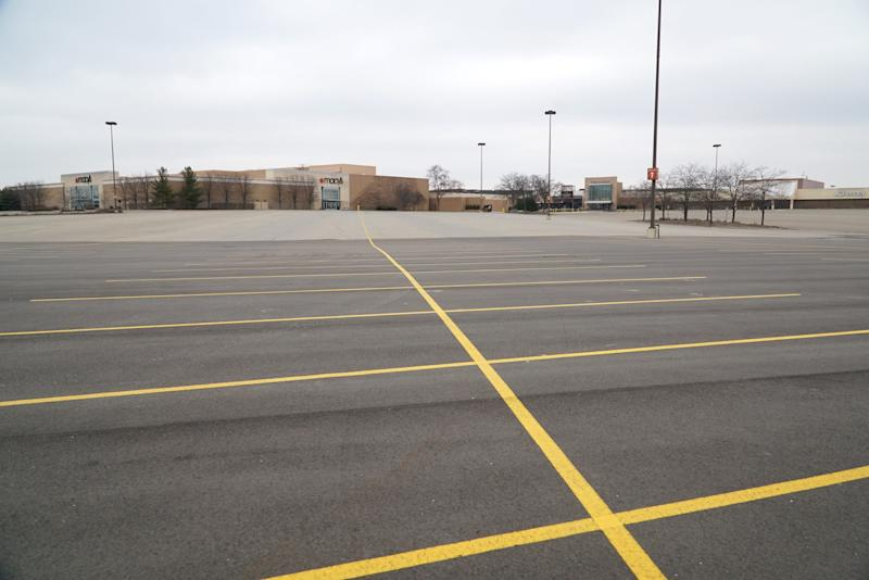 An empty parking lot at Taubman Centers' Twelve Oaks Mall in Novi, Michigan, attests to the effect of the coronavirus on the retail economy. Taubman Centers has closed most of its malls, including Twelve Oaks, until at least March 29.