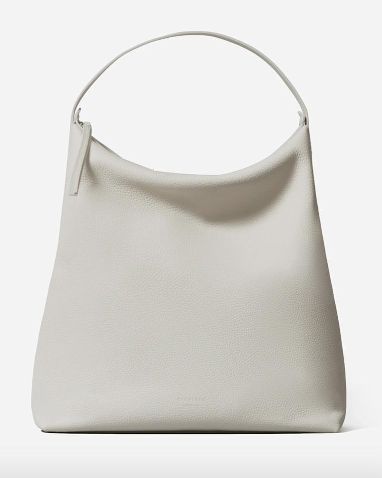 """$225, Everlane. <a href=""""https://www.everlane.com/products/womens-leather-boss-bag-pebbled-sandstone?collection=womens-leather-bags"""">Get it now!</a>"""