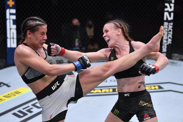 LAS VEGAS, NEVADA - NOVEMBER 21:  (R-L) Valentina Shevchenko of Kyrgyzstan and Jennifer Maia of Brazil exchange strikes in their women's flyweight championship bout during the UFC 255 event at UFC APEX on November 21, 2020 in Las Vegas, Nevada. (Photo by Jeff Bottari/Zuffa LLC)