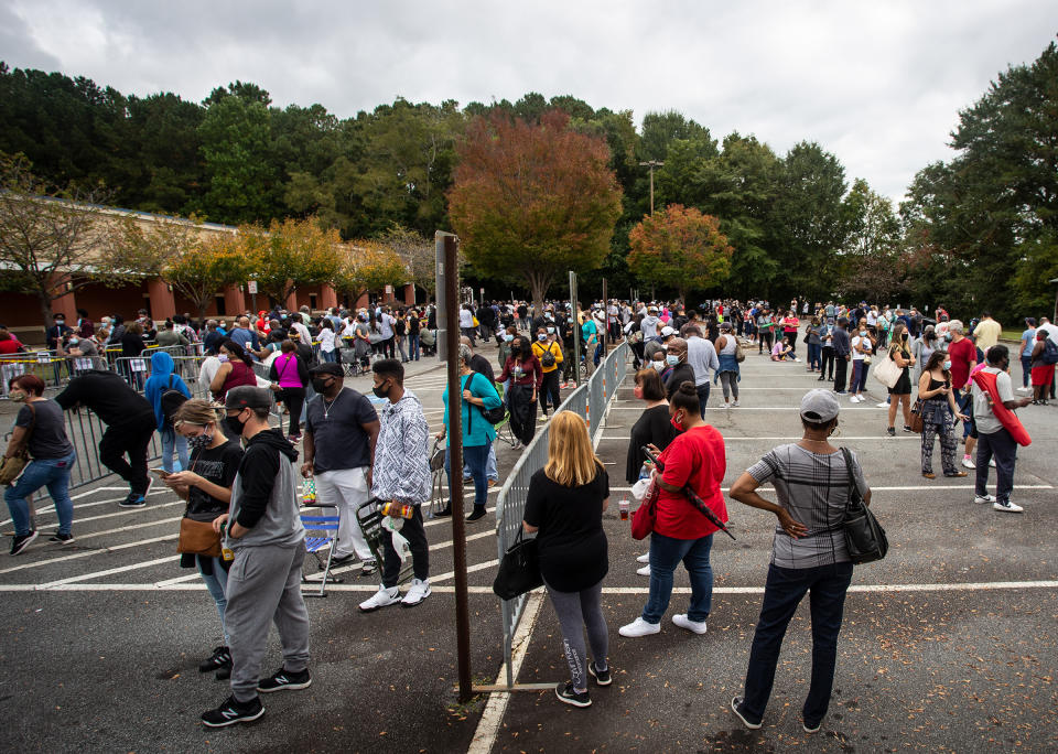 Hundreds of people wait in line for early voting on Monday, Oct. 12, 2020, in Marietta, Georgia. (Ron Harris/AP)