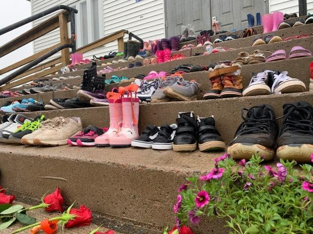 Children's shoes are shown on the steps of the church at the Sipekne'katik First Nation. (CBC - image credit)