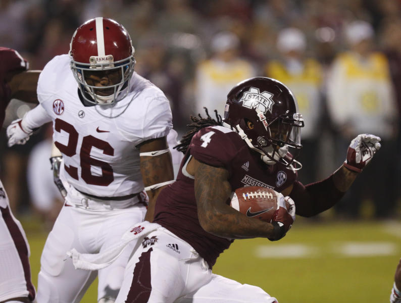 Mississippi State's Jameon Lewis (4) runs back a punt past Alabama's Landon Collins (26) during the first half of an NCAA college football game, Saturday, Nov. 16, 2013, in Starkville, Miss. (AP Photo/Rogelio Solis)