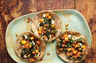 "These vegan tacos are well-stuffed with sweet squash, earthy kale, and crispy pumpkin seeds. <a href=""https://www.epicurious.com/recipes/food/views/butternut-squash-kale-and-crunchy-pepitas-taco-51249020?mbid=synd_yahoo_rss"" rel=""nofollow noopener"" target=""_blank"" data-ylk=""slk:See recipe."" class=""link rapid-noclick-resp"">See recipe.</a>"