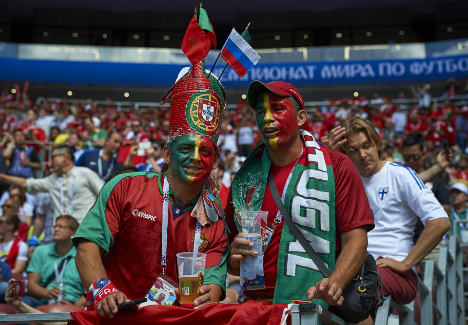 <p>Portu-geezers: Fans of the European champions cover themselves in red and green. (Getty) </p>