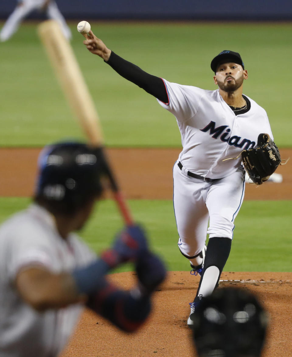 Miami Marlins' Pablo Lopez pitches to Atlanta Braves' Ronald Acuna Jr. during the first inning of a baseball game, Sunday, June 9, 2019, in Miami. (AP Photo/Wilfredo Lee)