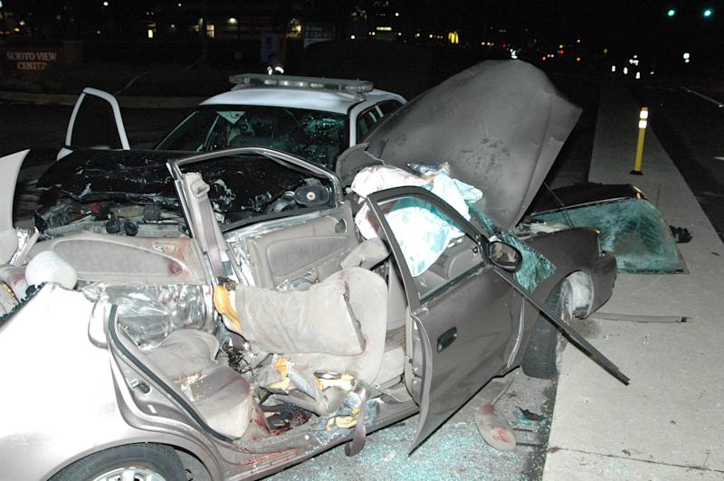 This photo provided by the Columbus Police shows an accident involving a police cruiser and a stopped car on Oct. 18, 2013. An Ohio police officer whose cruiser slammed into a stopped car in the middle of an intersection tried to veer away but couldn't avoid the crash that killed six members of a family, and there is no basis to charge him, authorities announced Thursday, Feb. 20, 2014. Investigators concluded that the other driver entered a Columbus-area intersection despite a red light and was struck on the side by an Upper Arlington police cruiser that was responding to a middle-of-the-night robbery call with its lights and sirens activated. The Oct. 18 crash killed the driver, his wife and four of their daughters, and the police officer was seriously hurt. (AP Photo/Columbus Police)