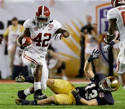 Alabama's Eddie Lacy ran through and over the Notre Dame defense. (AP)