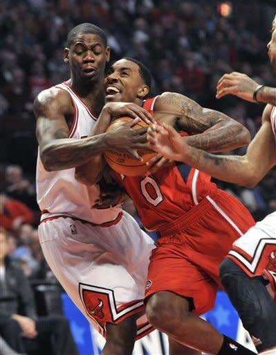 Chicago Bulls guard Ronnie Brewer, left, forces a jump ball as Atlanta Hawks guard Jeff Teague drives to the basket during the first quarter of an NBA basketball game, Monday, Feb. 20, 2012, in Chicago. (AP Photo/Brian Kersey)