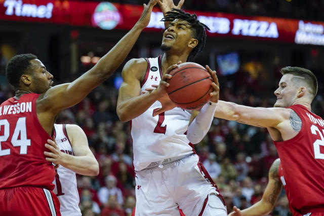 Wisconsin's Aleem Ford (2) is fouled by Ohio State's Kyle Young, right, during the second half of an NCAA college basketball game Sunday, Feb. 9, 2020, in Madison, Wis. Ohio State's Andre Wesson (24) looks on. (AP Photo/Andy Manis)