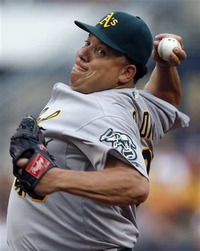 Oakland Athletics starting pitcher Bartolo Colon throws against the Pittsburgh Pirates in the first inning of the baseball game on Monday, July 8, 2013, in Pittsburgh. (AP Photo/Keith Srakocic)