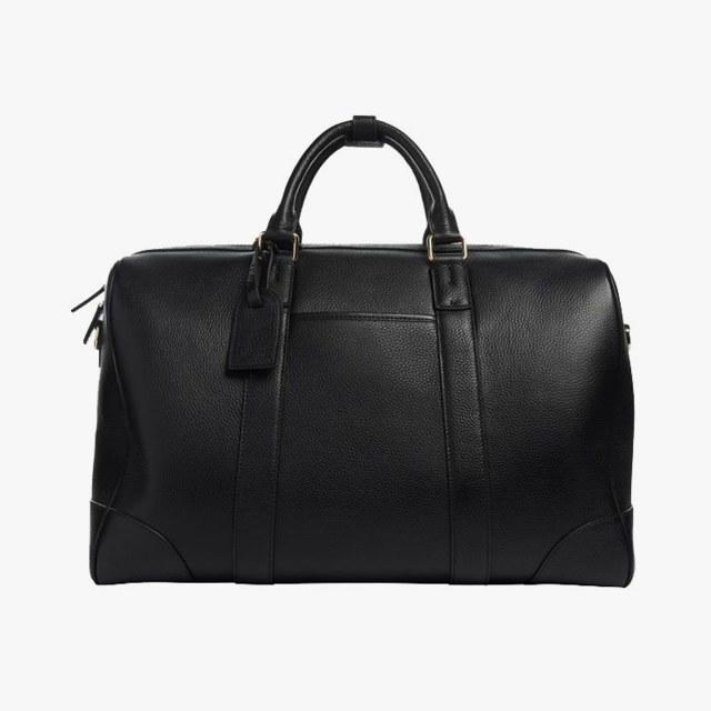 The Daily Edited black pebbled duffel bag, $410, thedailyedited.com