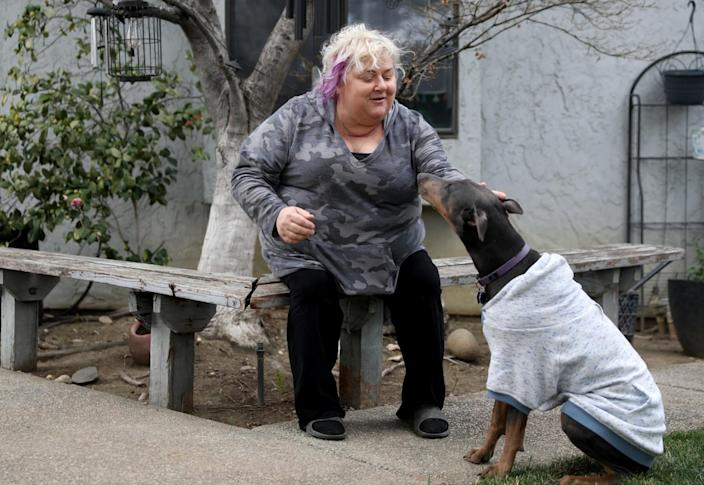 Patricia Mason and her dog, Cocoa, at her home in Vacaville.